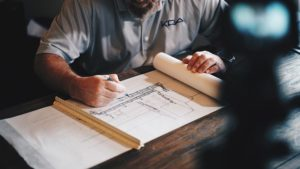 Architect drafting, Photo by Daniel McCullough on Unsplash
